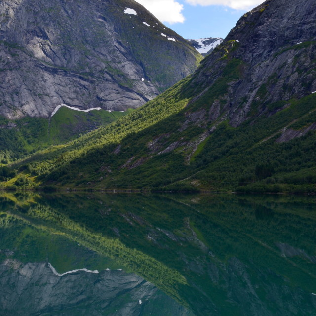 """Mountain reflections in the fjord"" stock image"