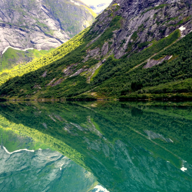 """Reflection in the fjord, Norway"" stock image"