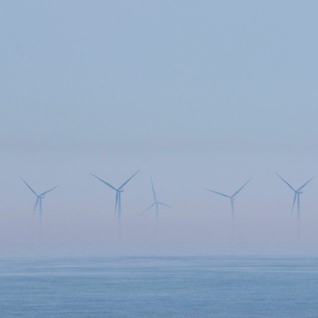 """Wind Turbines In The Mist."" stock image"