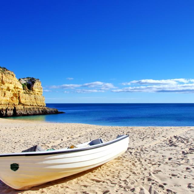 """""""Fishing boat in the sand. Algarve, Portugal."""" stock image"""