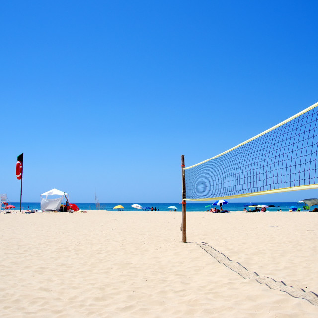 """Beach Volleyball net on sandy beach"" stock image"