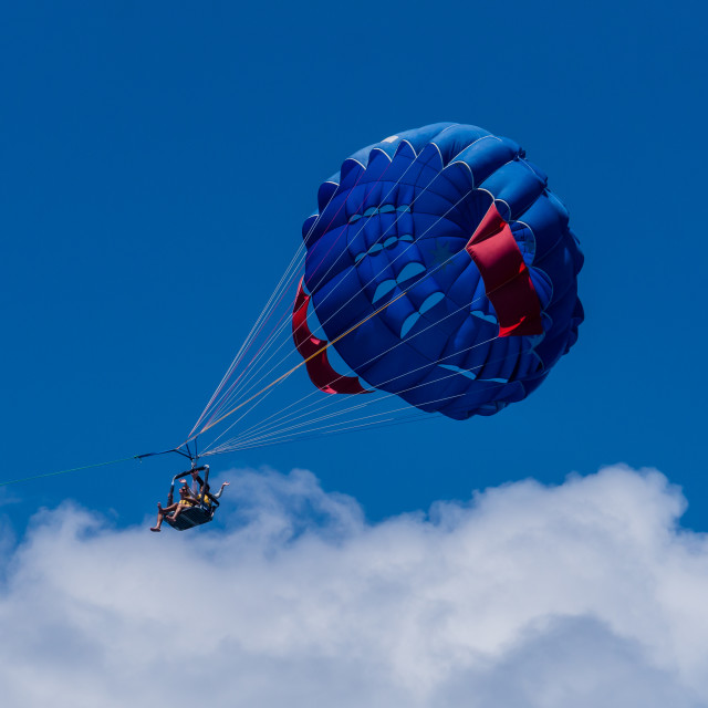"""Flying in pulled parachute"" stock image"