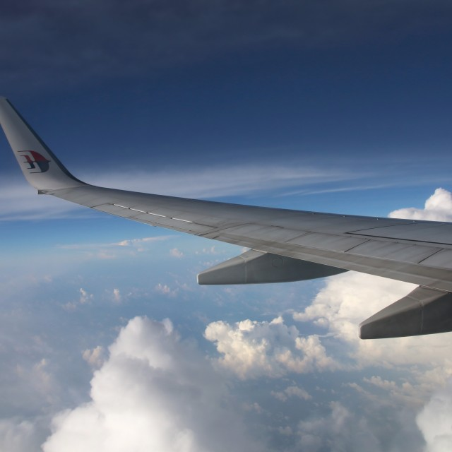 """Clouds and wing"" stock image"
