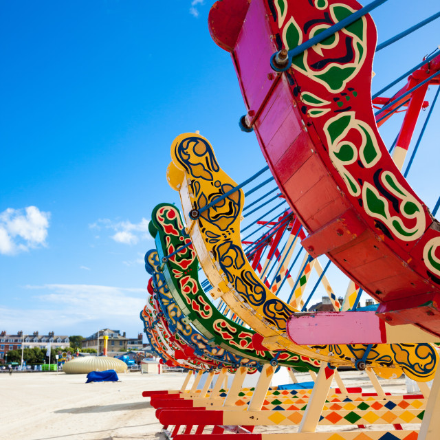"""""""Swing boats on the beach"""" stock image"""