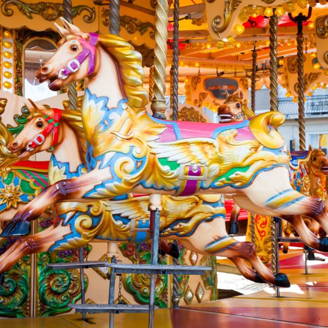 """Fairground carousel horses"" stock image"