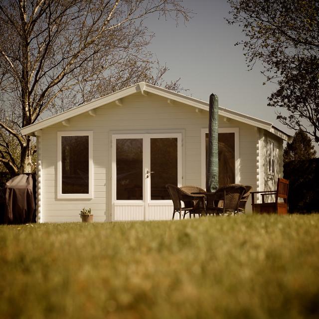 """Luxury Summerhouse in Country Garden"" stock image"