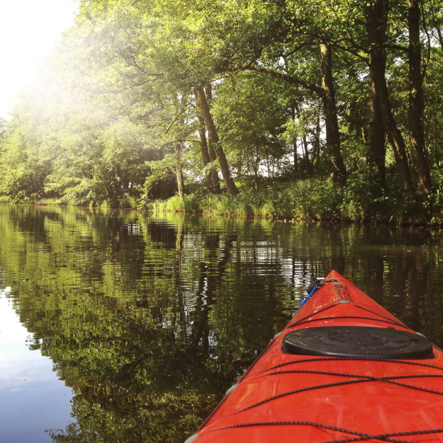 """Kayaking in the afternoon sun"" stock image"