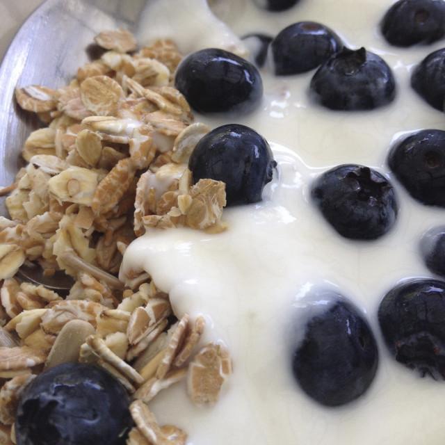 """Breakfast of oats, yoghurt and blueberries"" stock image"