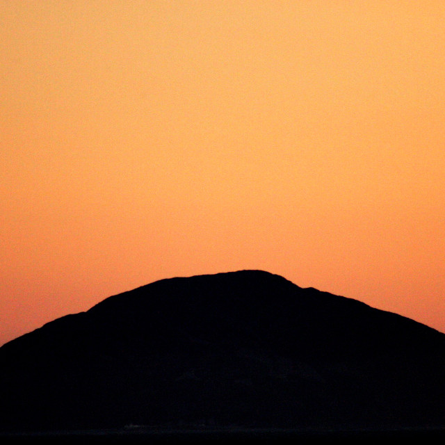 """Sunset behind the Ailsa Craig"" stock image"