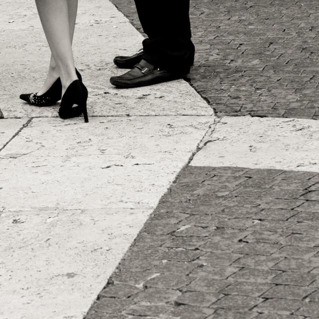 """Couple standing on cobblestone"" stock image"