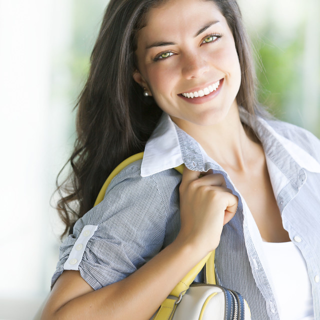 """Sympathetic young woman smiling"" stock image"