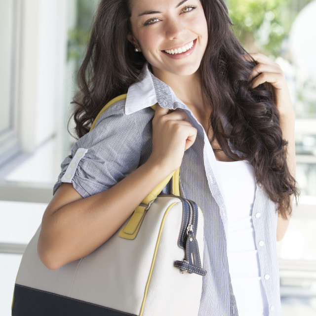 """Young woman with bags"" stock image"
