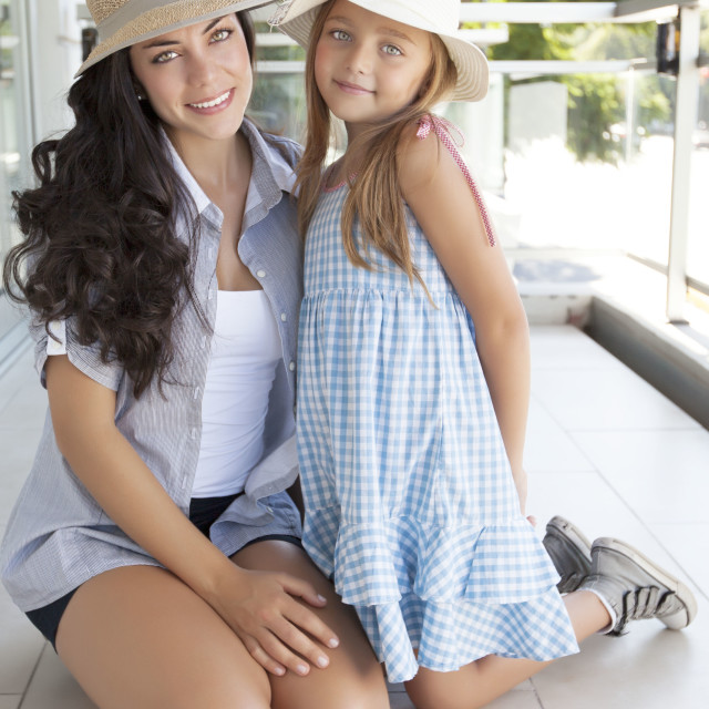 """Beautiful and young mother with her nice daughter"" stock image"