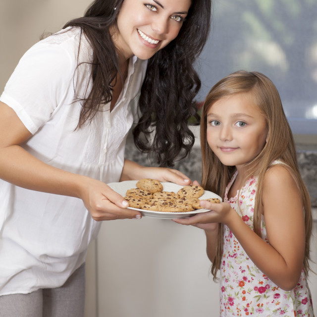 """Mother and daughter looking at camera"" stock image"