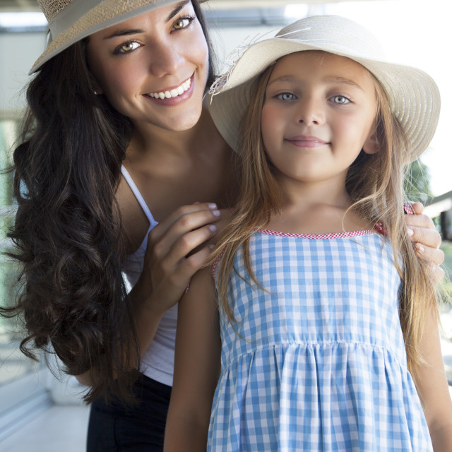 """Mother and daughter with hat"" stock image"