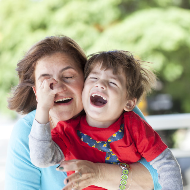 """Furious boy with her mother"" stock image"