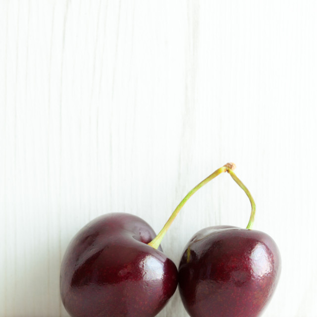 """Two joined cherries"" stock image"