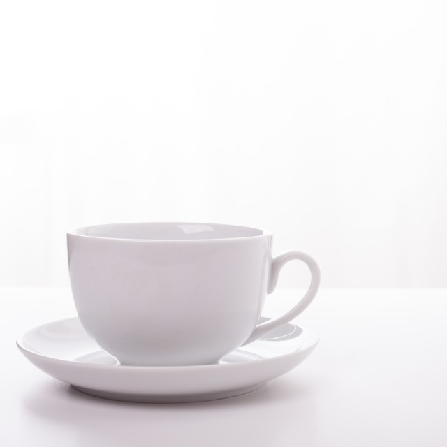 """White cup and saucer"" stock image"
