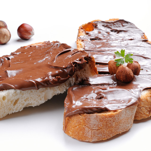 """""""Bread with chocolate cream and hazelnuts isolated"""" stock image"""