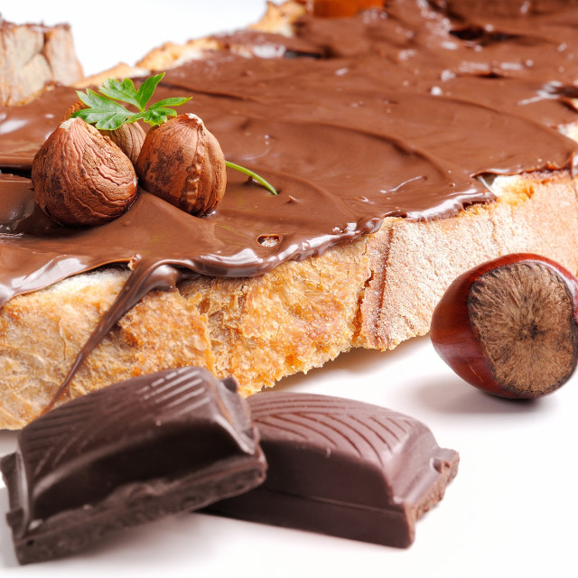 """""""Bread with chocolate cream and hazelnuts closeup"""" stock image"""