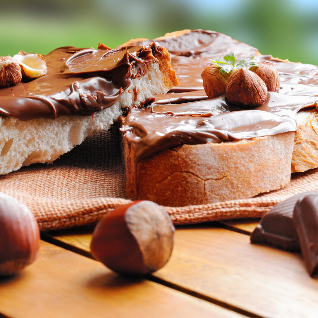 """""""Bread with chocolate cream and hazelnuts outdoor front view"""" stock image"""