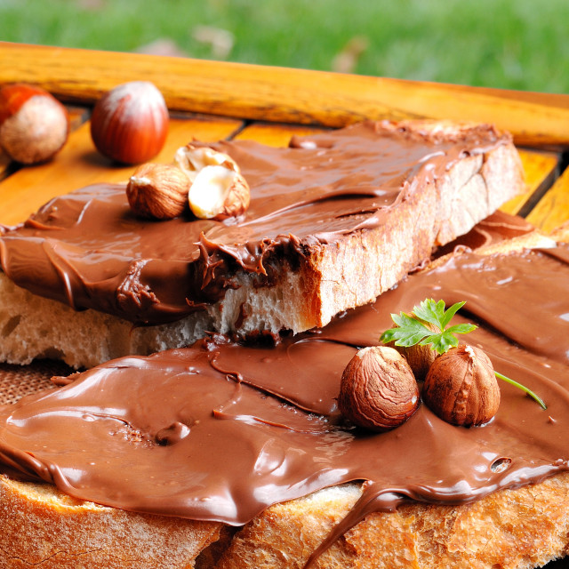 """""""Bread with chocolate cream and hazelnuts outdoor vertical compos"""" stock image"""