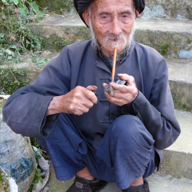"""""""Pipe Smoking Chinese Man"""" stock image"""
