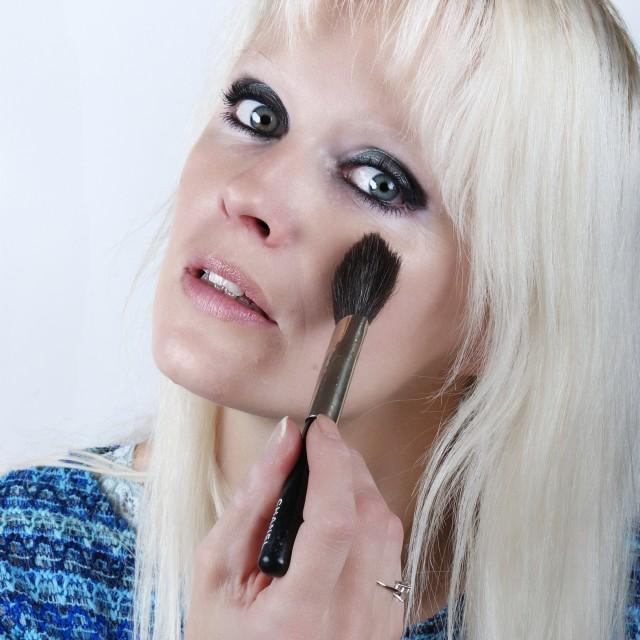 """Woman applying makeup"" stock image"