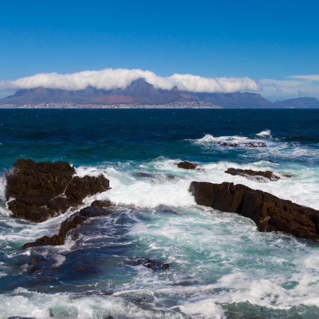 """View of Table Mountain, South Africa, with the top hidden by clouds. Taken from Robben Island on a beautiful sunny day."" stock image"