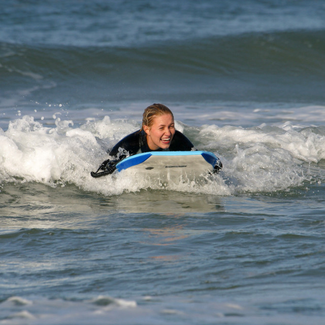 """Female Bodyboarder at Salthill"" stock image"