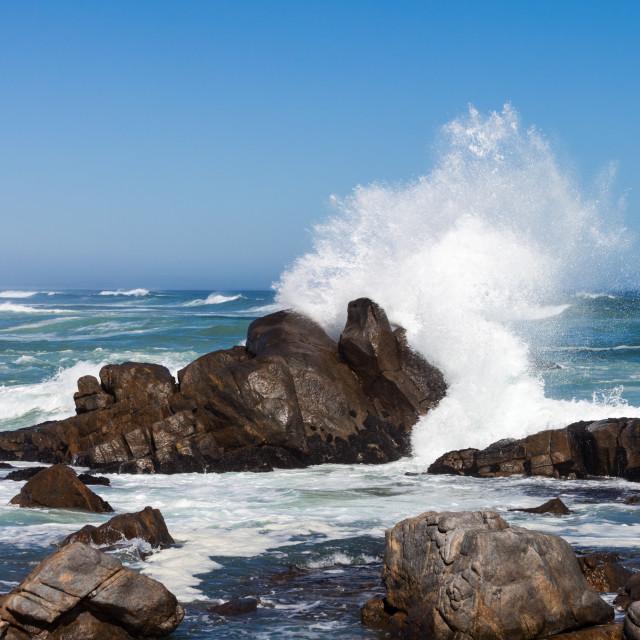 """Waves crashing against boulders"" stock image"