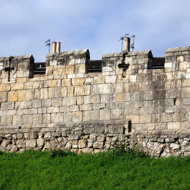 """Mediaeval city walls - and TV antennas!"" stock image"