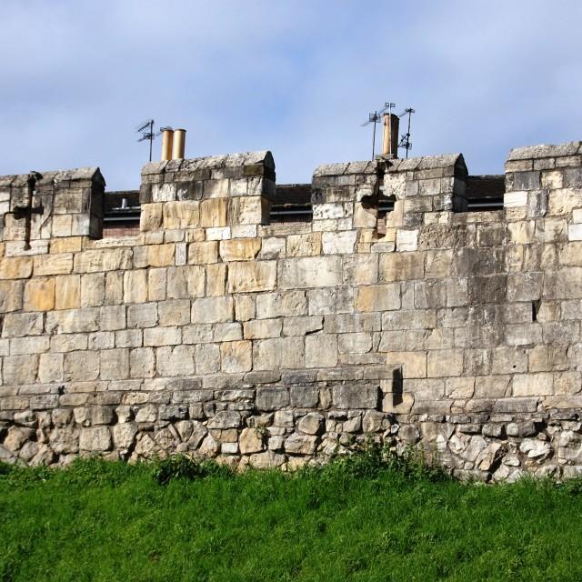 """Mediaeval city walls - and TV antennas!"" stock image"
