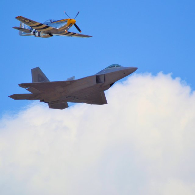 """F-22 Raptor and P-51D Mustang"" stock image"