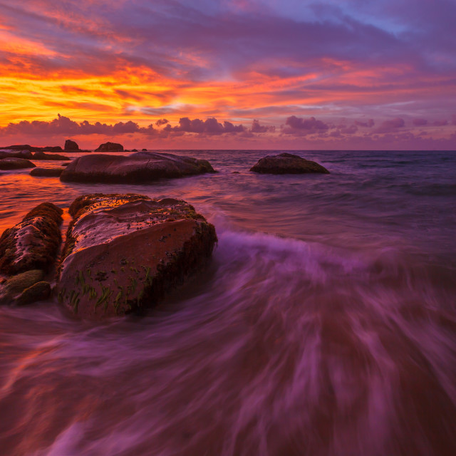 """""""Sunrise with rocks at beach in the morning"""" stock image"""
