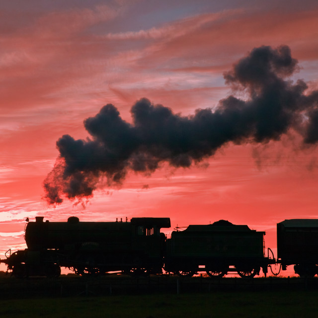 """Steam sunset silhouette"" stock image"