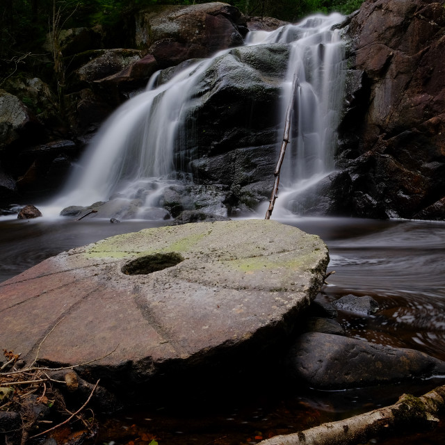 """Old millstone"" stock image"