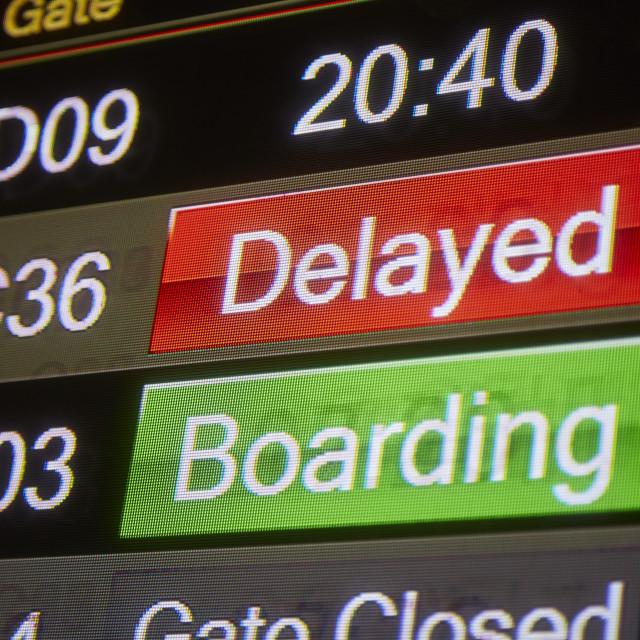 """Delayed Flight sign at airport terminal"" stock image"