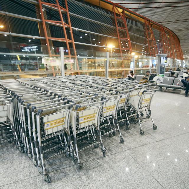 """Luggage carts inside airport terminal"" stock image"