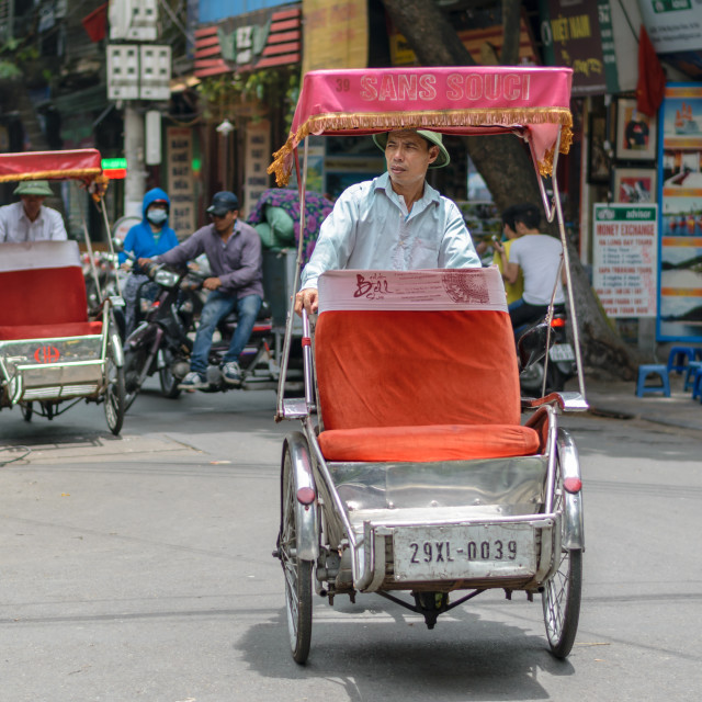 """Man with cyclos human transportation in the Hanoi city of Vietnam"" stock image"