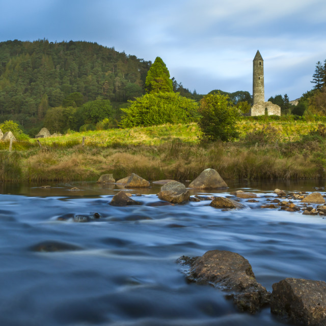 """""""The Round Tower and Church at Glendalough, Ireland."""" stock image"""