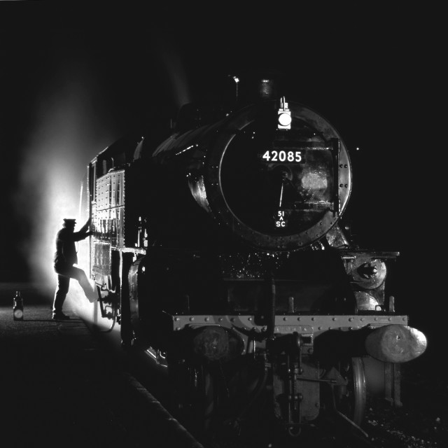"""Fireman mounting his locomotive."" stock image"