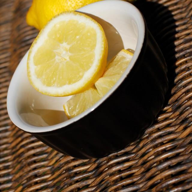 """""""Refreshing Sliced Lemon Outdoors on Wooden Wicker"""" stock image"""