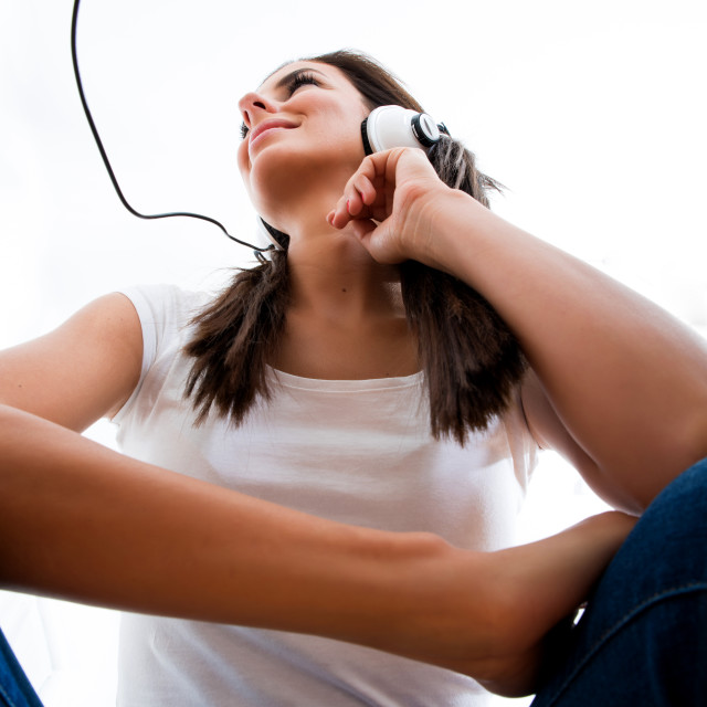 """Young beautiful woman listening to audio"" stock image"