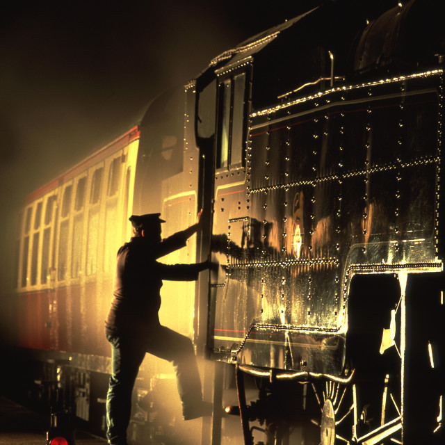 """""""Fireman about to mount his locomotive."""" stock image"""