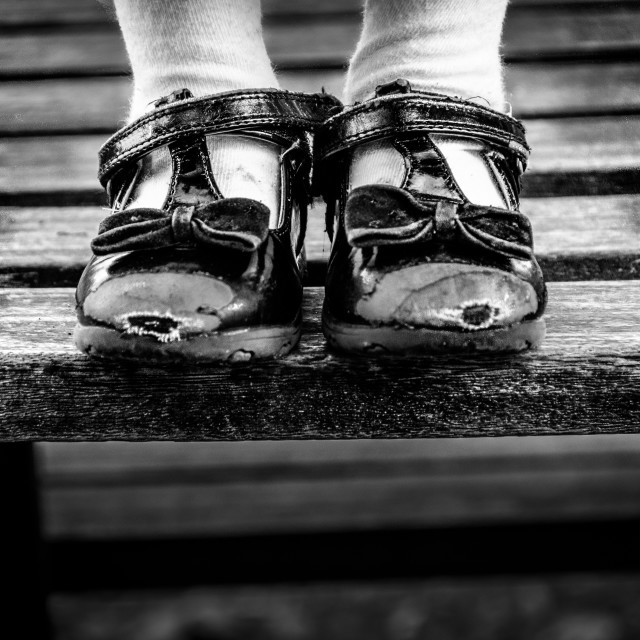 """""""Worn out toes and black bows"""" stock image"""