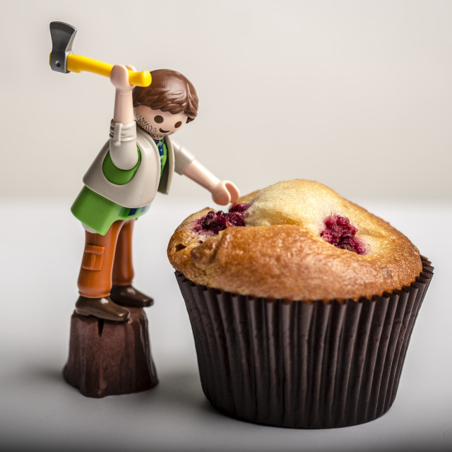 """""""Hacking a Muffin with an Axe"""" stock image"""