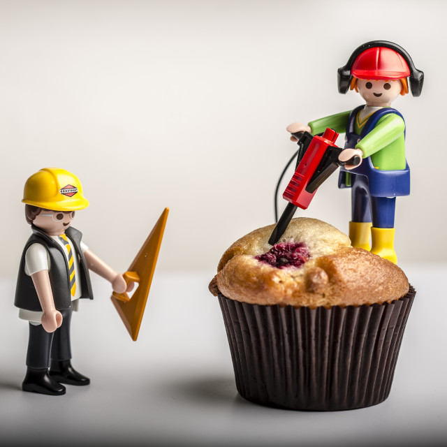 """""""Drilling a Muffin with a Jackhammer"""" stock image"""