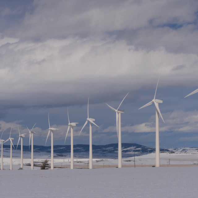 """Long row of wind turbines in the winter"" stock image"
