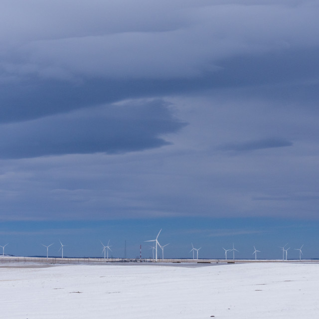 """Winter wind turbines in the distance"" stock image"